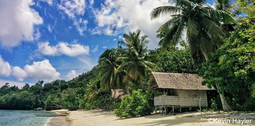 Gam Island, a tropical paradise on a budget. A typical beach hut in Raja Ampat, Papua, Indonesia