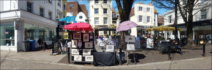 Selling and taking art commissions from a street stall in Brighton