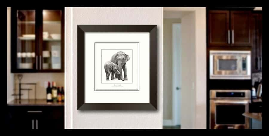 Framing an elephant print on a budget. Picture hanging on a wall.