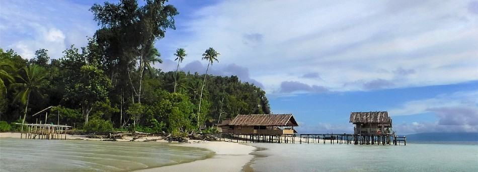 Solo Travel to the beach huts in Raja Ampat. Papua, Indonesia