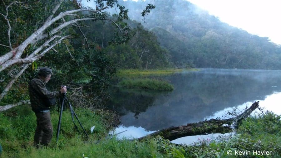 In search of orangutans in Sumatra. Tommy photographing Marpunge lake in Gunung Leuser National park