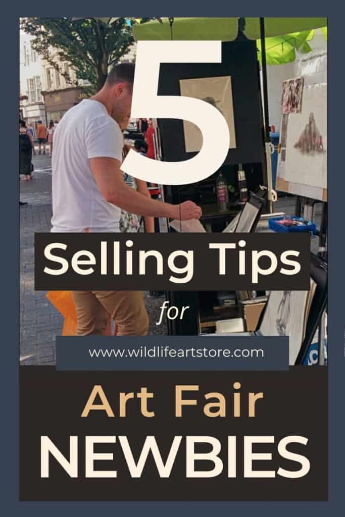 5 Selling tips for Art Fairs. A beginners guide. For Pinterest Man browsing a portfolio of artwork